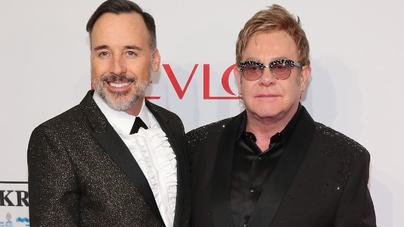 David Furnish, left, and Sir Elton John married in December 2014 in Britain. They had a civil partnership ceremony in 2005 after 12 years together.