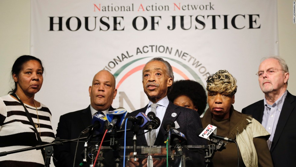 The Rev. Al Sharpton, center, speaks about the killings of the officers during a news conference at the National Action Network headquarters in New York on December 21. Behind him are, from left, Esaw Garner, widow of Eric Garner; attorney Michael Hardy; Gwen Carr, mother of Eric Garner; and attorney Jonathan Moore.