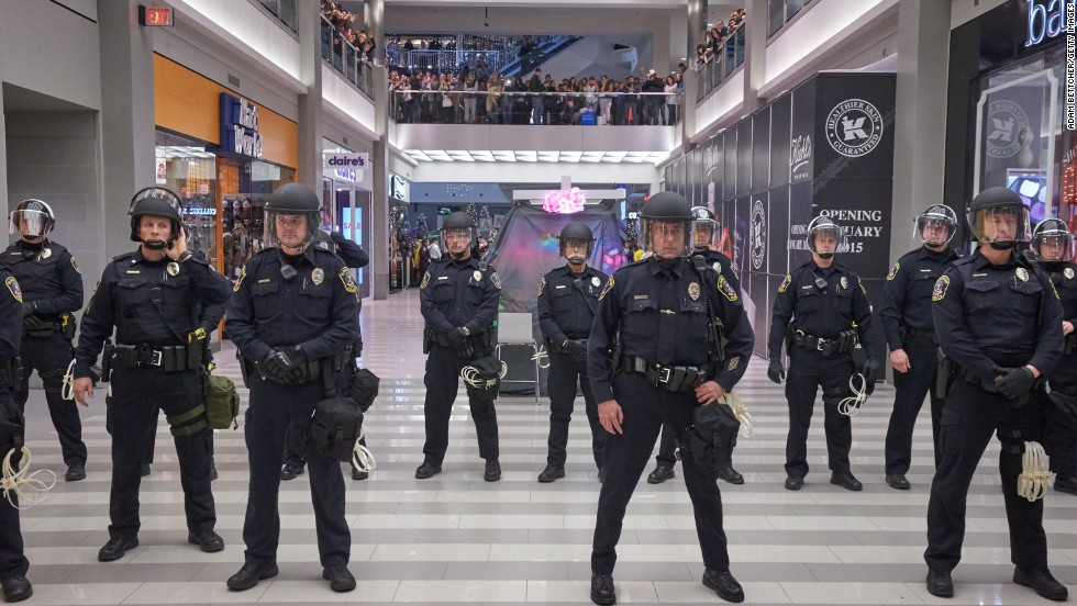 Police line up to move the protesters from out of the mall on December 20 in Bloomington.
