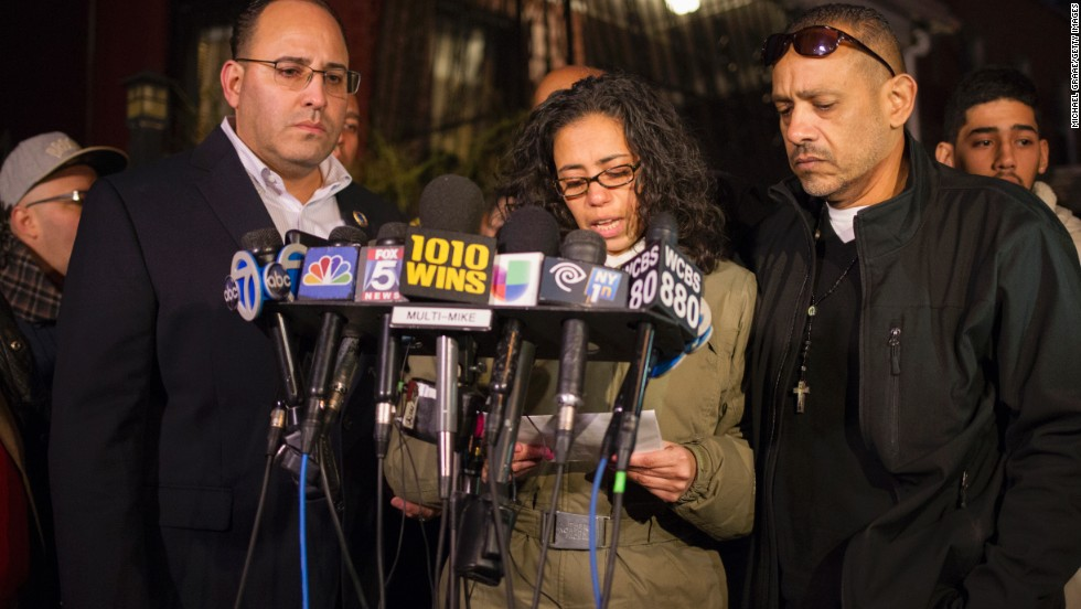 Lucy Ramos, aunt of slain police officer Rafael Ramos, speaks at a news conference in front of Ramos' childhood home on December 21.