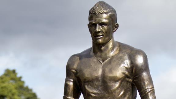 "Cristiano Ronaldo's bronze statue stands outside his ""CR7 Museum"" in his hometown of Funchal on the Portuguese island of Madeira."