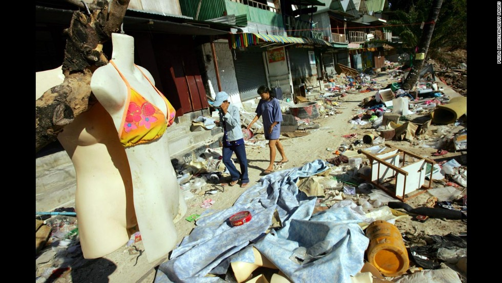 The 10th anniversary of the 2004 Indian Ocean earthquake and tsunami, which killed almost 250,000 people, will be remembered on December 26. Here, people walk through the streets of Tsunami-damaged Phi Phi Village on January 25, 2005, almost one month after the storm hit Ton Sai Bay in Kho Phi Phi, Thailand.