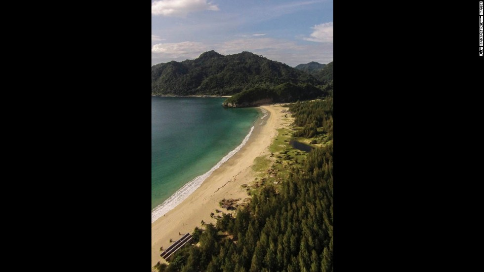 A recent aerial view of coastal Aceh shows the beach restored and trees regrown.
