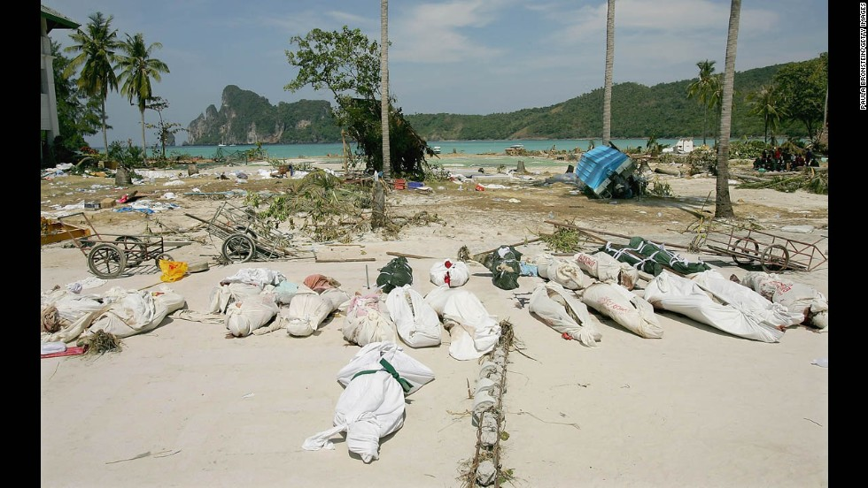 Bodies lay covered in the street waiting to be transported by boat from Phi Phi Village to Phuket and Krabi on December 28, 2004.