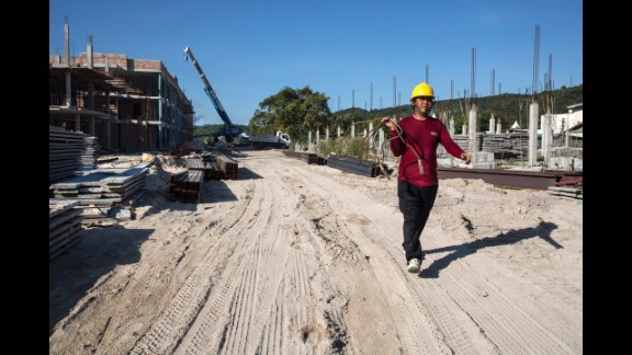 A construction worker walks where buildings are being erected on December 11, 2014, in Phi Phi Village, Ton Sai Bay, Thailand.