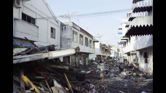 A man looks for relatives amid bodies and debris in Banda Aceh on December 28, 2004.