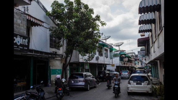 Ten years later, the debris has been cleared and people drive on Pembangunan Street.