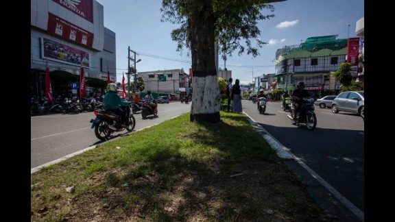 People drive along Panglima Polim Street 10 years later.
