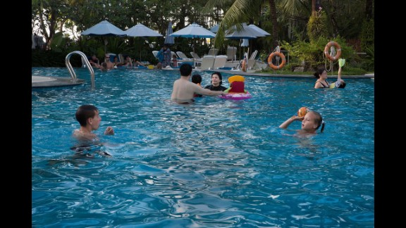 Children play in the renewed pool at the Holiday Inn Phuket Resort and Hotel on December 10, 2014.
