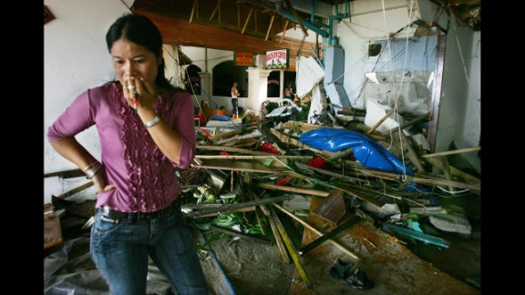 A Thai woman looks at the damage in a hotel in Phuket on December 27, 2004.
