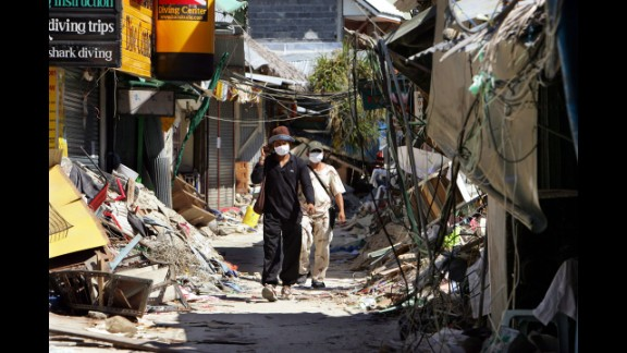 People walk through the streets of tsunami-damaged Phi Phi Village on January 25, 2005, almost one month after the tsunami hit Ton Sai Bay.