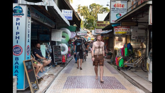 A decade later, people walk between stores in Phi Phi Village.
