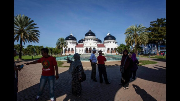 People gather near the Grand Mosque a decade after the tsunami.