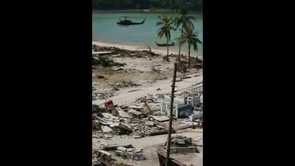 A helicopter lands with emergency supplies on December 28, 2004, in Phi Phi Village.