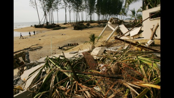 Debris and collapsed buildings are seen on December 29, 2004, at the Theptharo Resort in Khao Lak, where many tourists died when their bungalows were swept away by the tsunami.