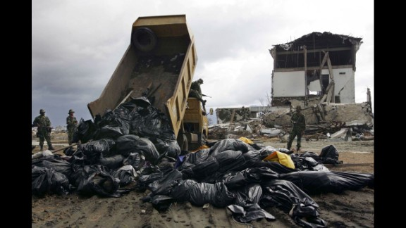 Members of the Indonesian military unload corpses to be buried on January 9, 2005, in Banda Aceh.