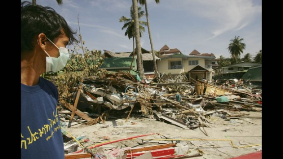 A Thai rescue worker looks at the destruction of hotels and shops on December 28, 2004, in Phi Phi Village.