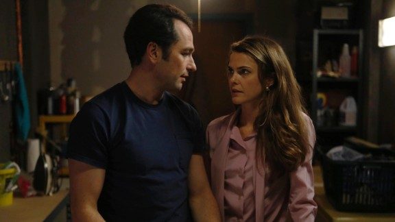 """""""The Americans"""": Matthew Rhys and Keri Russell are captivating in this FX '80s-era series about a pair of Russian spies undercover as suburban American parents. With season three on the way on January 28, now is the perfect time to get lost in this suspenseful drama."""