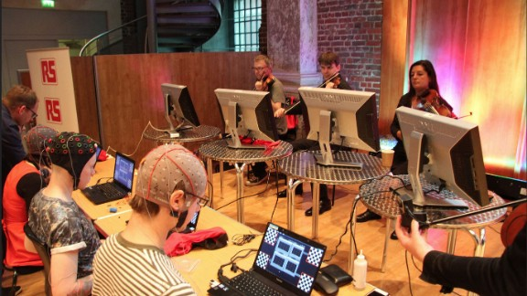 Miranda's latest composition is for a string quartet. It is an interaction between eight people, four of them generating music while the remaining four perform the composition as its being generated. Here, the professional string quartet get ready to play at the Music Tech Festival in September 2014.