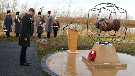 Prince William takes a moment to remember those who fought in WWI in front of the memorial designed by 10 year-old Spencer Turner from Newcastle.