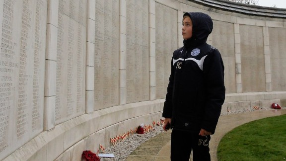 One of the young players takes time to read the names on the Menin Gate at Ypres. Clubs from 10 European countries took their teams to the tournament where they learned about the history of the First World War.
