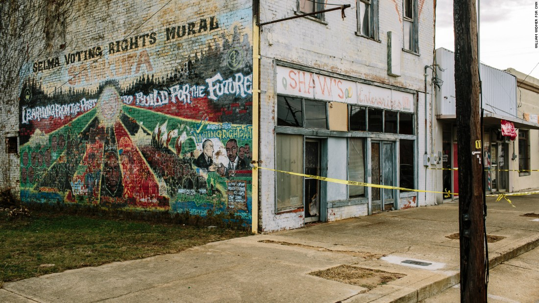 A civil rights mural decorates the side of a dilapidated building in downtown Selma. Nearly 42% of the city's population lives under the federal poverty line.