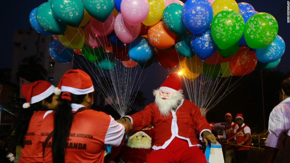 Santa distributes candy during a Christmas carnival in Mumbai, India.