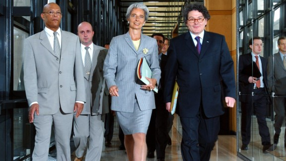 In June 2005, Lagarde joined the French government as Minister for Foreign Trade under French President Jacques Chirac.   She is seen here with French Minister of Economy Thierry Breton (R) arriving at a press conference in Paris, France.