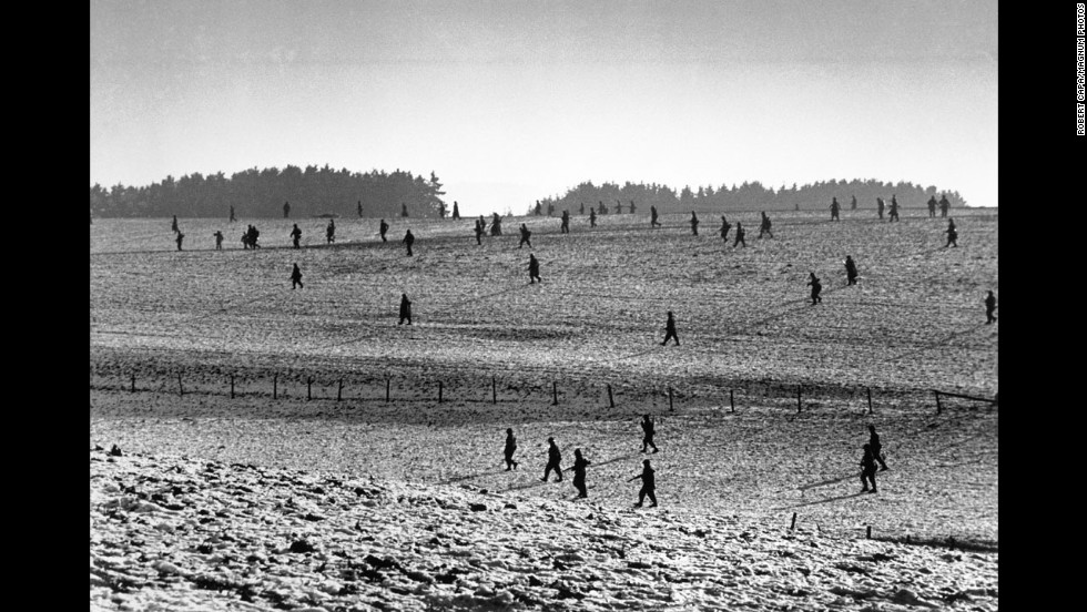 U.S. soldiers scatter across a field during the Battle of the Bulge. The Allies eventually turned back a major German offensive in the Ardennes region of Belgium, Luxembourg and France.