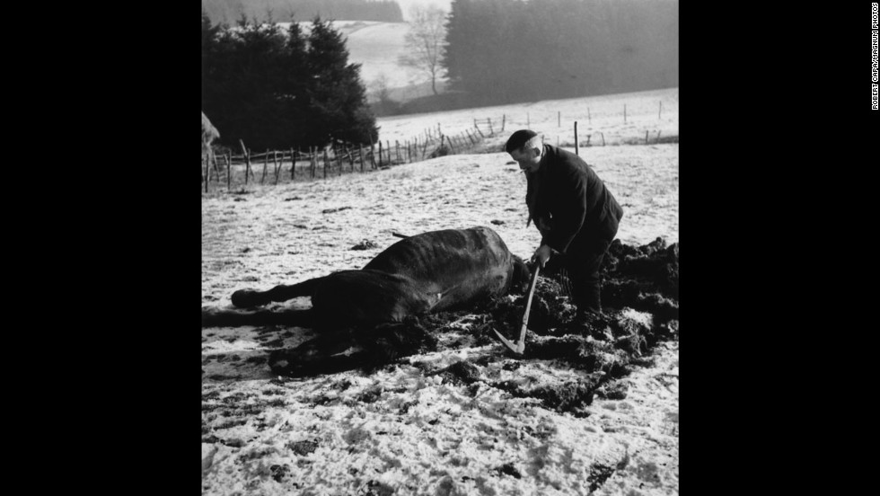 A farmer buries his horse that had been killed during the fierce fighting.