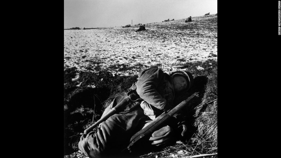 An American soldier rests in his foxhole during the Battle of the Bulge.
