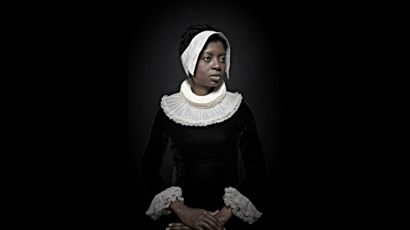 """A woman poses in 17th-century clothing as part of Maxine Helfman's photo series """"Historical Correction."""" Helfman shot the series in 2012, posing black subjects to look like old Flemish paintings."""