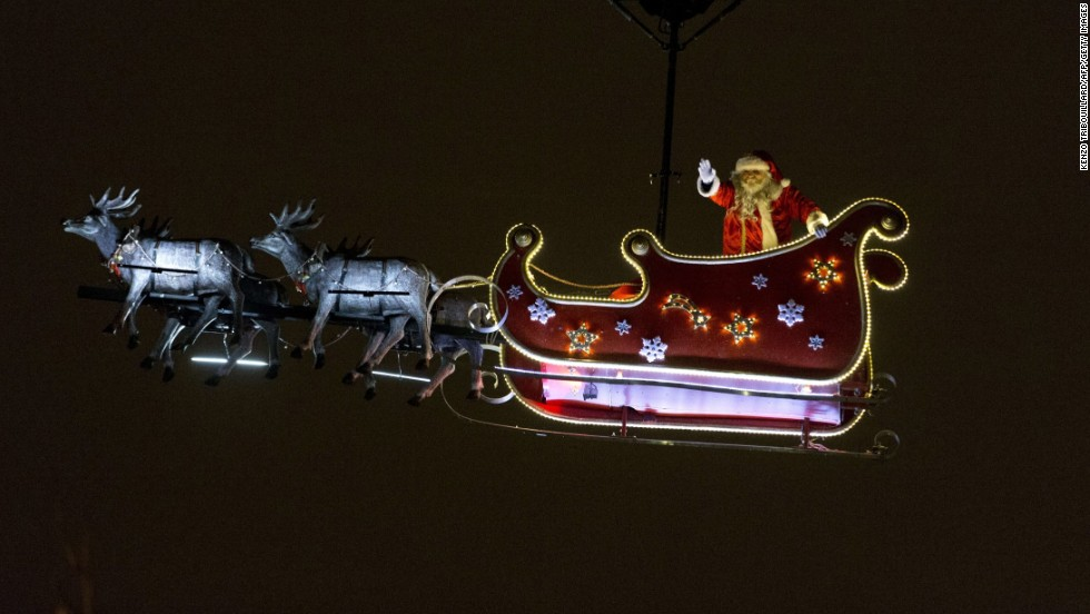 A Santa waves from his sleigh on the Champs-Élysées in Paris.
