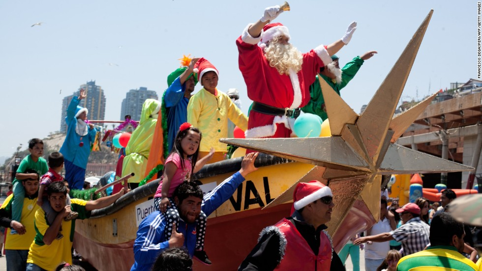 A fisherman in Santa disguise joins in the holiday celebrations  in Valparaiso, Chile.