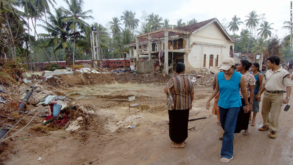 People walk among the rubble of the tsunami in Hambantota, Sri Lanka in January 2005. The Indian Ocean tsunami struck on 26 December 2004, causing massive destruction along coastal areas of 14 countries, including Thailand, India, Sri Lanka, Indonesia and Malaysia.