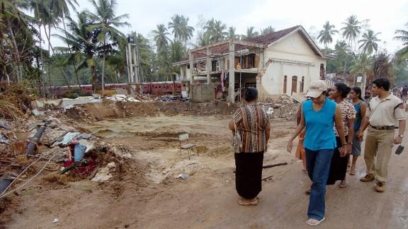 People walk among the rubble of the tsunami in Hambantota, Sri Lanka in January 2005. The Indian Ocean tsunami struck on 26 December 2004, causing massive destruction along coastal areas of 14 countries, including Thailand, India, Sri Lanka, Indonesia and Malaysia.