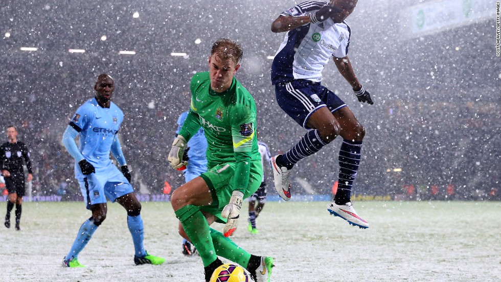 Heavy snow hit the WBA - Man City clash at the Hawthorns but it did not stop the visitors winning 3-1 to keep up pursuit of Chelsea.