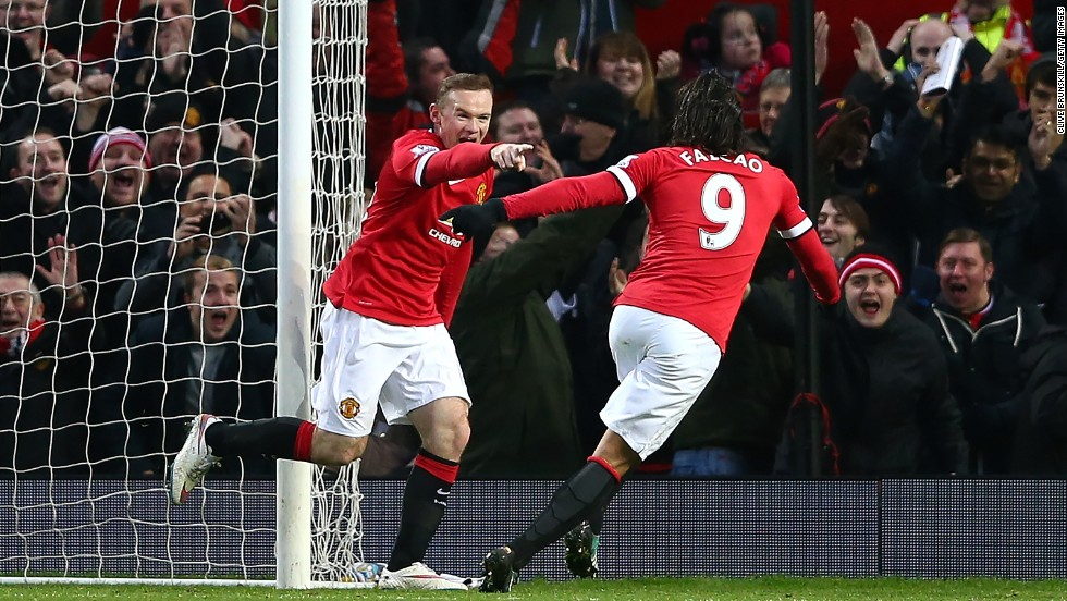 Wayne Rooney is congratulated by Radamel Falcao after scoring during Manchester United's 3-1 win over Newcastle to stay third.