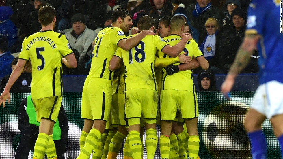 Tottenham Hotspur players congratulate Christian Eriksen after his second half winner in the 2-1 victory at bottom side Leicester.