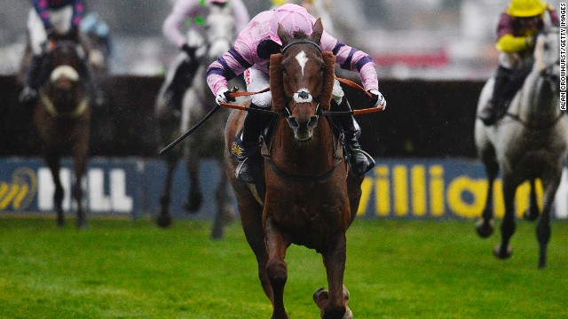 Silviniaco Conti powers clear of the field under jockey Noel Fehily to win the King George VI at Kempton Park.