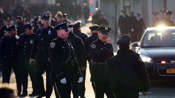 Police officers gather outside the church.