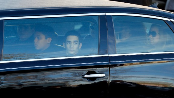 Family members of officer Ramos, including sons Jaden and Justin and his wife, Maritza Ramos, in backseat, arrive for the funeral.