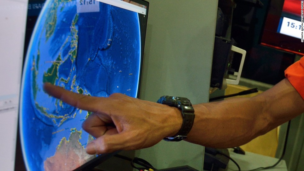 An official from Indonesia's national search and rescue agency points to the position where AirAsia Flight QZ8501 went missing.