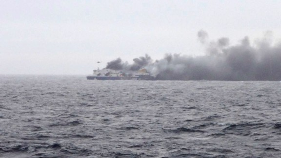 In this photo taken from a nearby ship, smoke rises from the Italian-flagged Norman Atlantic after it caught fire in the Adriatic Sea, Sunday, Dec. 28, 2014. The ferry carrying hundreds of passengers caught fire off the Greek island of Corfu early Sunday, trapping passengers on the top decks as gale-force winds and choppy seas hampered the evacuation. (AP Photo/SKAI TV Station) GREECE OUT, MANDATORY CREDIT