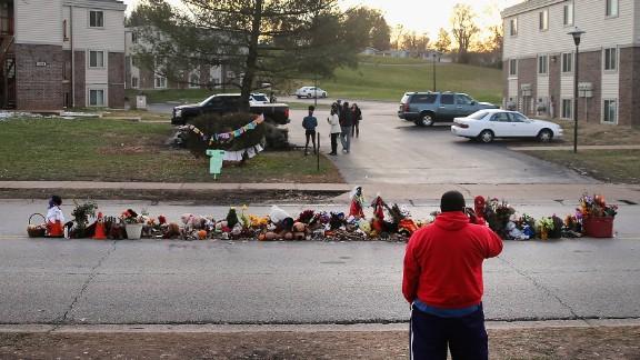 Visitors look at the Michael Brown memorial in Ferguson, Missouri, on November 28.