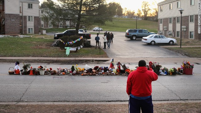 Visitors look at the Michael Brown memorial in Ferguson, Missouri, on November 28.
