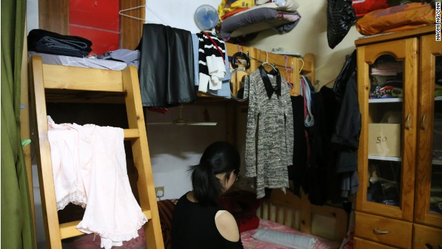 Joyce, Ngan Chau Yee shares a bunk bed with her mother and younger brother.