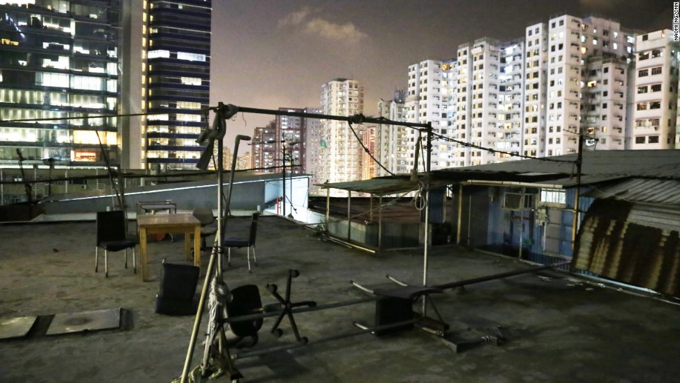 This rooftop dwelling in Kwun Tong accommodates around 40 people. Residents often use this open area for gatherings or to air-dry their laundry.