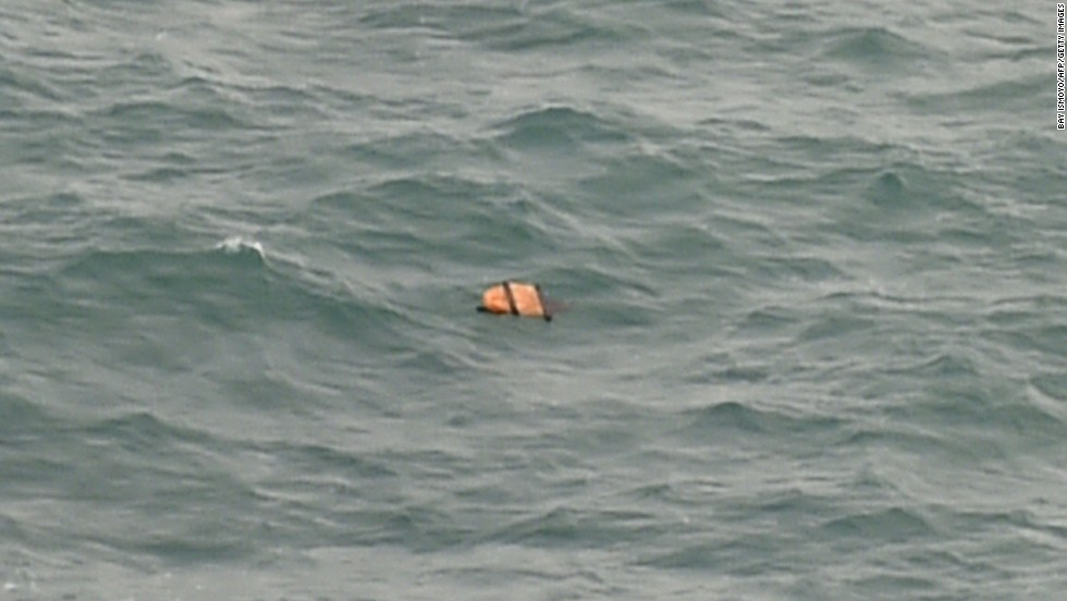 Debris floats in the Java Sea on December 30.