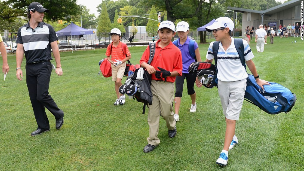 Rory McIlroy (left) hosts a junior golf clinic in New York in 2012. The world No. 1 is an ambassador for junior golf  -- a role that could be vital in keeping the younger generation interested in the sport.
